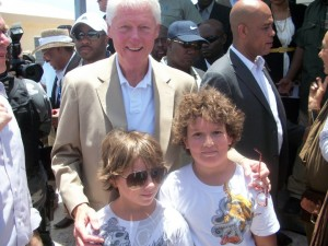 "My kids, age 10, at the innaguration of ""my"" housing project in Port-au-Prince in July 2011. Pres Martelly in the background, Wyclef Jean."